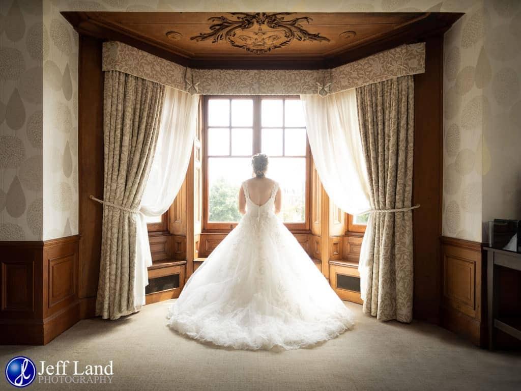 Wedding, Photographer, Wood Norton Grange, Bride in Bay Window